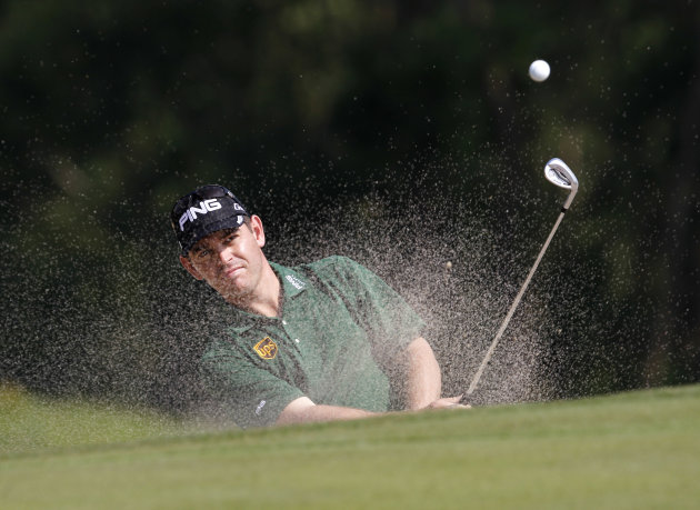 Louis Oosthuizen from South Africa hits the bunker shot at the 9th hole during the round 2 match of the WGC- HSBC Champions golf tournament in Dongguan, southern China's Guangdong province, Friday Nov. 2, 2012. (AP Photo/Kin Cheung)
