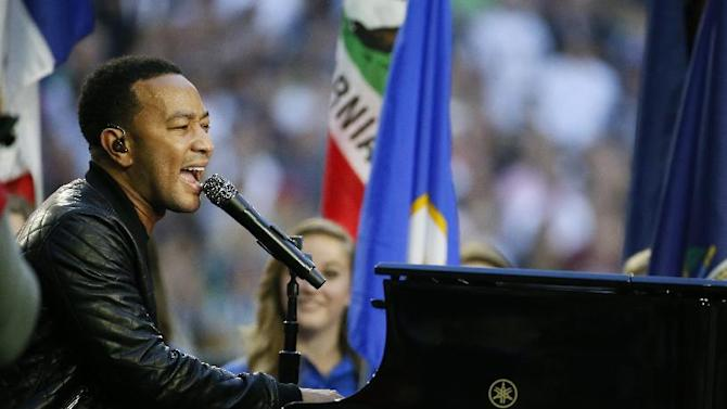 Singer John Legend performs America the Beautiful before the NFL Super Bowl XLIX football game between the Seattle Seahawks and the New England Patriots Sunday, Feb. 1, 2015, in Glendale, Ariz