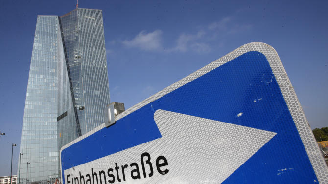 In this picture taken Wednesday Sept. 17, 2014, a one-way-road traffic sign stands in front of the new headquarters of the European Central Bank in Frankfurt, Germany. The European Central Bank launched its new stimulus program aimed at getting banks to lend more in a slack economy — but saw less demand than expected for its offering of super-cheap credit. The central bank for the 18-country eurozone on Thursday, Sept. 18, 2014, handed out 82.6 billion euros (US dollar 107 billion) in ultra-cheap loans to 255 banks. The ECB is supposed to move into the building by the end of the year. (AP Photo/Michael Probst)