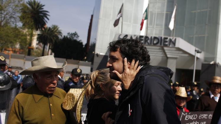 Andres Manuel Lopez Beltran, the son of leftist leader Andres Manuel Lopez Obrador, is greeted by a supporter during a protest against an energy reform bill at the Senate building in Mexico City