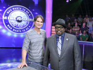 "This Aug. 16, 2013, photo provided by Disney-ABC Domestic TV shows Associated Press writer Frazier Moore, left, with host Cedric ""The Entertainer"" during a test show of the game show ""Who Wants To Be A Millionaire"" in New York. On Sept. 2, the new season premieres, ushering in Cedric ""The Entertainer"" as host. (AP Photo/ Disney-ABC Domestic Television, Heidi Gutman)"