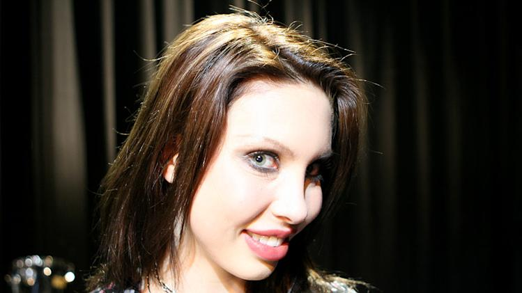 Chloe Lattanzi, daughter of singer Olivia Newton-John, stars in Rock The Cradle.