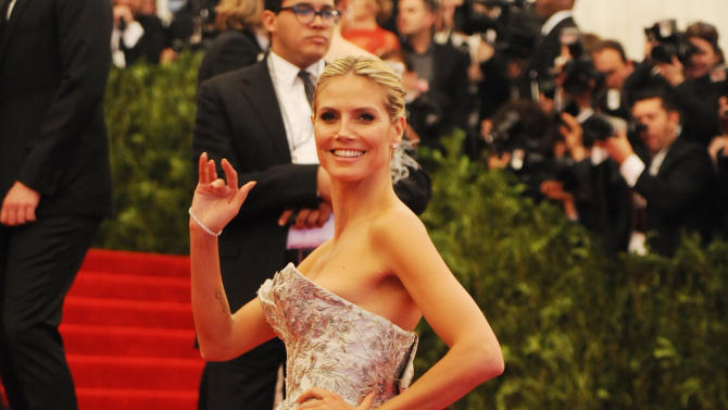 """Heidi Klum attends The Metropolitan Museum of Art's Costume Institute benefit celebrating """"PUNK: Chaos to Couture"""" on Monday, May 6, 2013 in New York. (Photo by Evan Agostini/Invision/AP)"""
