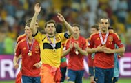 Spanish goalkeeper Iker Casillas waves to supporters after winning the Euro 2012 football championships final match Spain vs Italy at the Olympic Stadium in Kiev. Spain won 4-0