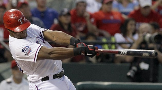 Texas Rangers&#39; Adrian Beltre follows through on hitting a home run during the fourth inning of a baseball game against the Baltimore Orioles, Wednesday, Aug. 22, 2012, in Arlington, Texas. (AP Photo/LM Otero)