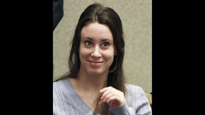 FILE - In this July 7, 2011 file photo, Casey Anthony smiles before the start of her sentencing hearing in Orlando, Fla.  A state appellate court is being asked to decide Tuesday Jan. 8, 2013 whether the Florida mother was in police custody when she made the statements that led to her being convicted of lying to law enforcement officers.  (AP Photo/Joe Burbank, File)