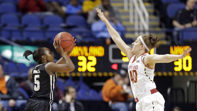 Wake Forest's Chelsea Douglas (5) shoots over Maryland's Katie Rutan (40) during the first half of an NCAA college basketball game at the Atlantic Coast Conference tournament in Greensboro, N.C., Friday, March 8, 2013. (AP Photo/Chuck Burton)