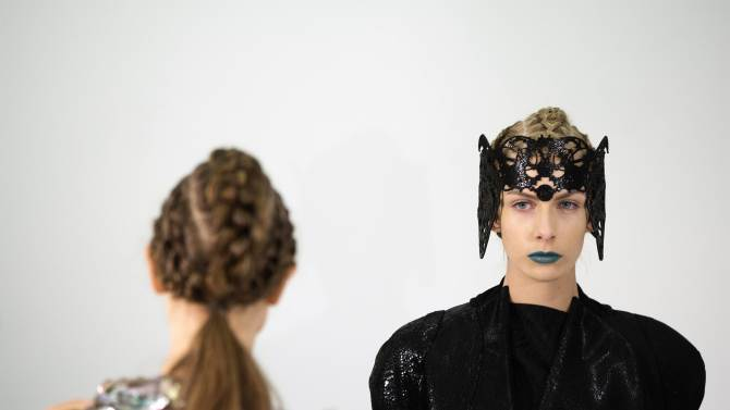 Models present creations from the threeASFOUR Autumn/Winter 2013 collection during New York Fashion Week