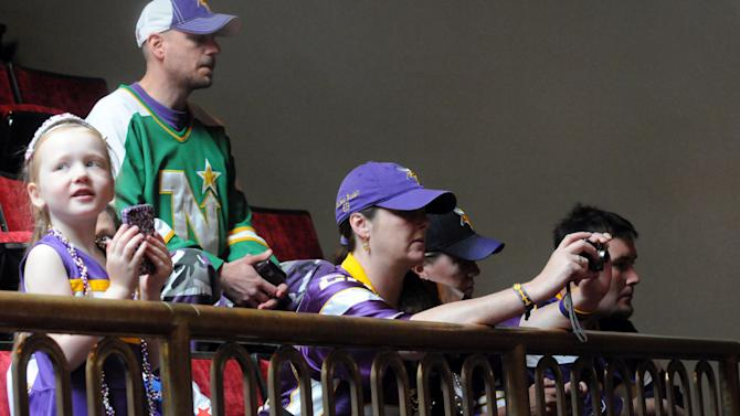 Minnesota Vikings fans watch the debate during a Minnesota Senate session in St. Paul, Minn., on Thursday, May 10, 2012. The Senate has begun debate on a financing plan for a new Minnesota Vikings stadium. Hours after the Minnesota House gave its support to the plan -- which increases the team's contribution to the venue by $50 million -- the Senate took it up Thursday. The deal is a compromise bill after a conference committee ironed out differences between earlier versions. (AP Photo/The St. Paul Pioneer Press, John Doman)  MINNEAPOLIS STAR TRIBUNE OUT, MAGS OUT