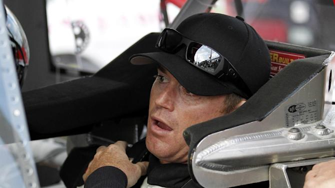 Timothy Peters sits in his car waiting to drive qualifying laps for the NASCAR Trucks Series auto race, Friday, Nov. 16 2012 at the Homestead-Miami Speedway in Homestead, Fla.  (AP Photo/Terry Renna)