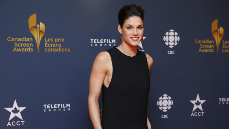 Actress Missy Peregrym arrives on the red carpet at the 2014 Canadian Screen awards in Toronto