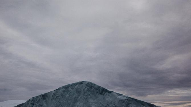 This July 18, 2011 photo shows the peak of a large iceberg shed from the Greenland ice sheet, outside Ilulissat, Greenland. (AP Photo/Brennan Linsley)