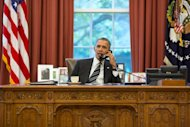 President Barack Obama talks with President Hassan Rouhani of Iran during a phone call in the Oval Office on September 27, 2013