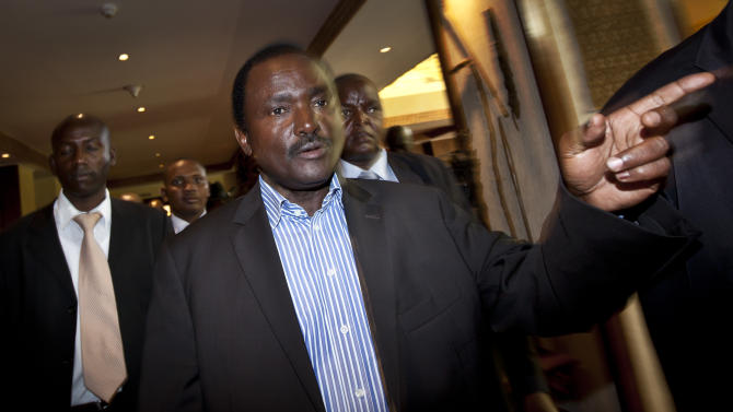 "Kalonzo Musyoka, center, Kenya's current Vice President and running mate of presidential candidate Raila Odinga, gestures as he leaves after speaking at a press conference in Nairobi, Kenya Thursday, March 7, 2013. The coalition of Kenya's prime minister Raila Odinga says the vote tallying process now under way to determine the winner of the country's presidential election ""lacks integrity"", should be stopped, and the counting process should be restarted using primary documents from polling stations. (AP Photo/Ben Curtis)"