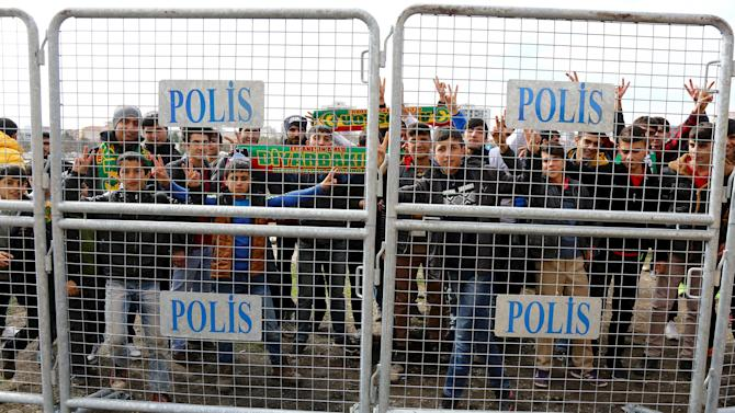 Amedspor fans gather behind security barriers before the Turkish Cup quarter final first leg soccer match between Amedspor and Fenerbahce in the Kurdish-dominated southeastern city of Diyarbakir