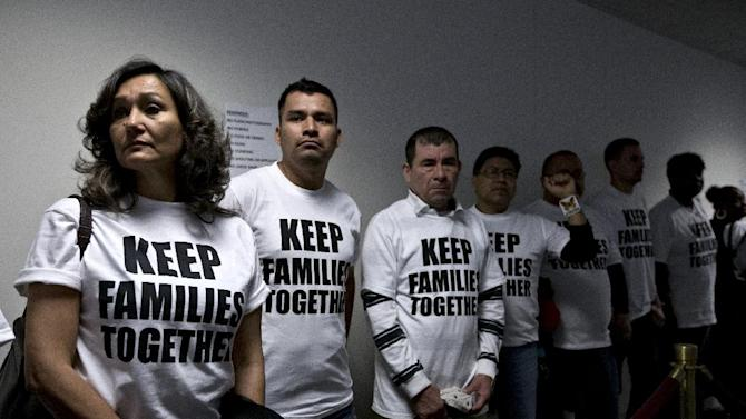 Immigration advocates gather outside the Senate Judiciary Committee in the Senate Hart Office Building on Capitol Hill in Washington, Monday, April 22, 2013, as they wait to attend the committee's hearing on comprehensive immigration reform legislation. (AP Photo/J. Scott Applewhite)