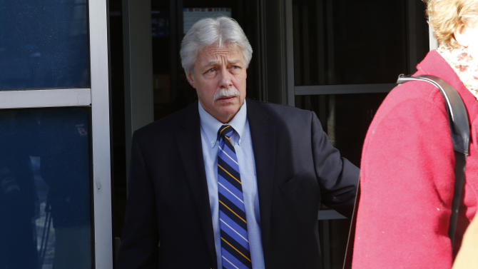 FILE - In this Jan. 18, 2013 file photo, Mark Strong Sr., leaves the Cumberland County Court House in Portland, Maine. The jury in Strong's trial watched a video Thursday, Feb. 28, 2013, showing a sexual encounter between Zumba fitness instructor Alexis Wright and a man who left cash on her massage table. Strong is charged with 13 counts that relate to promoting prostitution.  He contends he had an affair with Wright and helped her launch her Pura Vida dance studio in Kennebunk, Maine, but his lawyer has said he was unaware of any paid sex. (AP Photo/Robert F. Bukaty, File)