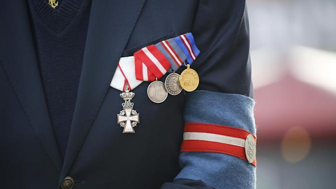 A WWII veteran is seated with his medals on his jacket Tuesday, May 5. 2015 at Nyhavn Port in Copenhagen, Denmark, during a ceremony in honor of the Fallen Danish Sailors with Crown Prince Frederik as a participant. Denmark on Tuesday marked the 70th anniversary of the liberation of Denmark from German occupation during WWII. (Jens Dresling/Polfoto via AP) DENMARK OUT