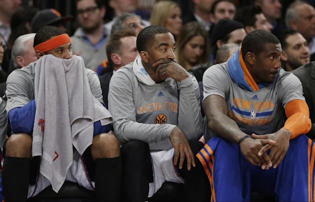New York Knicks' Carmelo Anthony, left, J.R. Smith, center, and Amar'e Stoudemire, right, watch their team play during the first half of an NBA basketball game against the Philadelphia 76ers M