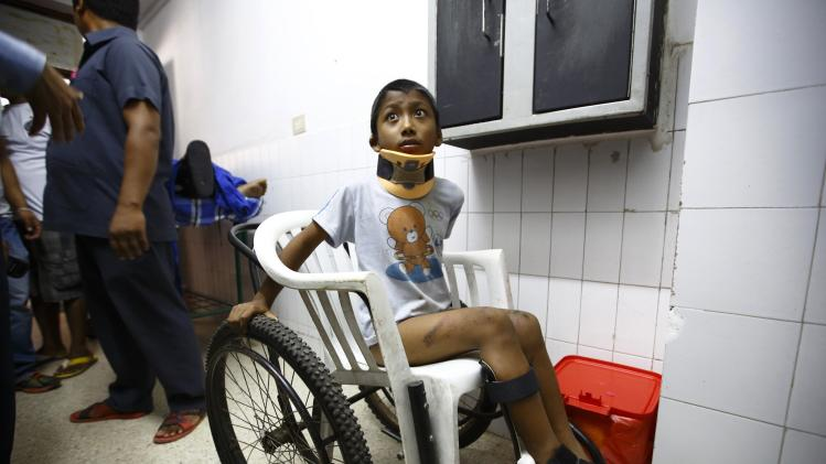 A boy waits to get his X-ray done at a hospital in Kathmandu after being rescued from a landslide in northeast Nepal