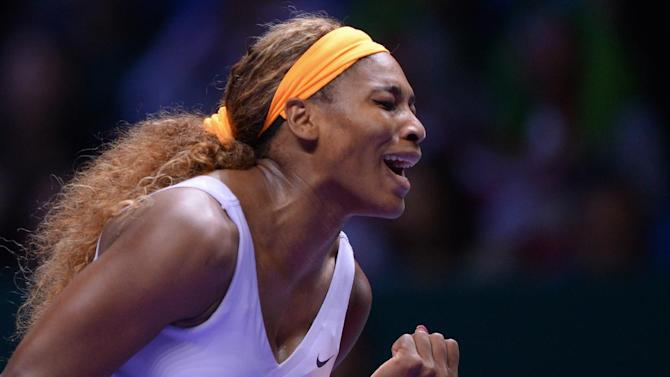 Serena Williams of the USA shouts after she returned a shot to Jelena Jankovic of Serbia during their semifinal tennis match at the WTA Championship in Istanbul, Turkey, Saturday, Oct. 26, 2013. The world's top female tennis players compete in the championships which runs from Oct. 22 until Oct. 27.(AP Photo)