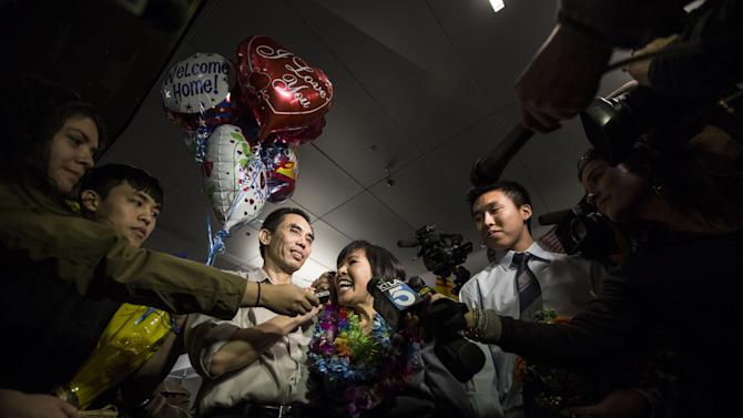 Human rights activist  Nguyen Quoc Quan with his wife Huong Mai Ngo and their sons Khoa, 20, and Tri, 19, speaks during a press conference after  his arrival at the Los Angeles International Airport from Vietnam on Wednesday, Jan. 30, 2013, in Los Angeles.  Quan has been released after being detained since April 17, 2012 in Ho Chi Minh City, Vietnam. (AP Photo/Ringo H.W. Chiu)