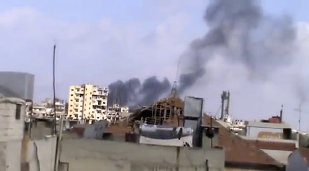 In this image taken from video obtained from the Shaam News Network, which has been authenticated based on its contents and other AP reporting, smoke rises from houses due to government shelling in Homs, Syria, on Friday, Oct. 5, 2012. (AP Photo/Shaam News Network via AP video)