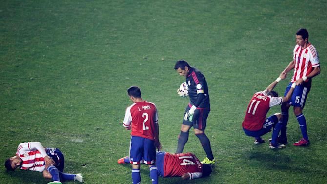 Paraguay's players react after Argentina's Gonzalo Higuain scored a goal during a Copa America semifinal soccer match at the Ester Roa Rebolledo Stadium in Concepcion, Chile, Tuesday, June 30, 2015. Argentina beat Paraguay 6-1 in the Copa America semifinals on Tuesday, setting up a final against host Chile. (AP Photo/Natacha Pisarenko)