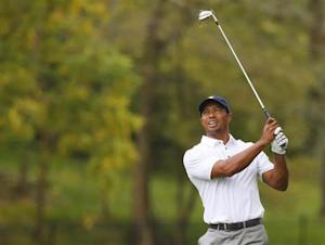 U.S. team member Tiger Woods his off a rain soaked 2nd fairway as he plays International team member Richard Sterne of South Africa during the Singles matches for the 2013 Presidents Cup golf tournament at Muirfield Village Golf Club in Dublin