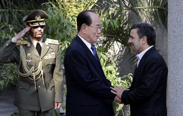 Iranian President Mahmoud Ahmadinejad, right, shakes hands with the president of the Presidium of North Korea's Supreme People's Assembly Kim Yong-nam, during an official welcoming ceremony in