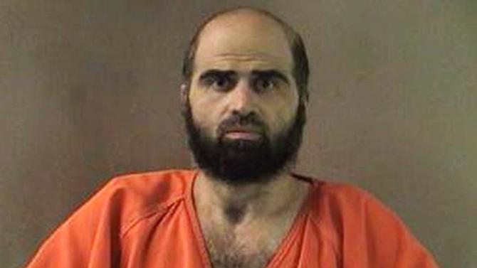 FILE - This undated file photo provided by the Bell County Sheriff's Department shows Nidal Hasan, the Army psychiatrist charged in the 2009 Fort Hood shooting rampage that left 13 dead. Tight security measures are in place at the Texas Army post and neighboring city of Killeen in preparation for the start of jury selection Tuesday, July 9, 2013, Hasan's capital murder trial. (AP Photo/Bell County Sheriff's Department, File)