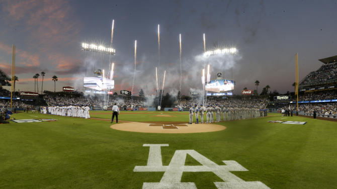 Members of the Los Angeles Dodgers, left, and the New York Mets line up before the start of Game 1 of baseball's National League Division Series, Friday, Oct. 9, 2015 in Los Angeles. (AP Photo/Gregory Bull)
