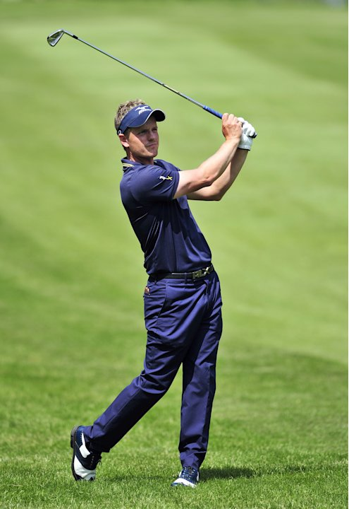 English golfer Luke Donald watches his a