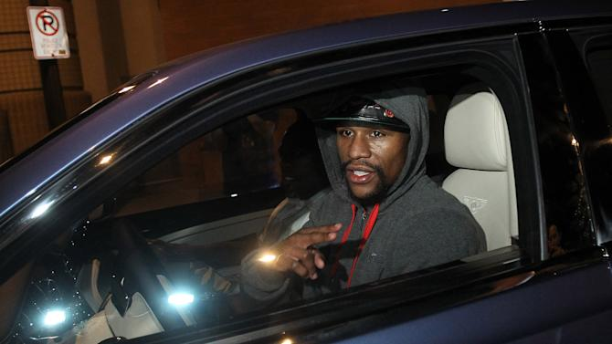 Floyd Mayweather Jr., leaves the Clark County Detention Center after serving two months of a three-month sentence in a misdemeanor domestic battery case, Friday, Aug. 3, 2012, in Las Vegas. (AP Photo/Isaac Brekken)