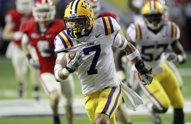 FILE - This Dec. 3, 2011 file photo shows LSU cornerback Tyrann Mathieu (7) returning a punt for a touchdown against Georgia during the first half of the Southeastern Conference championship NCAA college football game in Atlanta. LSU has dismissed Heisman Trophy finalist Mathieu from its football program for violating school and team rules. At a news conference Friday, Aug. 10, 2012, coach Les Miles would not specify the reason Mathieu was kicked off the team. (AP Photo/John Bazemore, File)