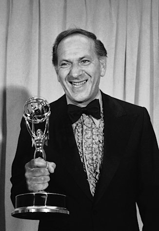 "FILE - In this May 20, 1973 file photo, Jack Klugman holds his Emmy for his role in ""The Odd Couple"" presented at the 25th Emmy Awards Banquet for outstanding continued performance by an actor in a leading role in a comedy series in Los Angeles. Klugman, the prolific, craggy-faced character actor and regular guy who was loved by millions as the messy one in TV's ""The Odd Couple"" and the crime-fighting coroner in ""Quincy, M.E.,"" died Monday, a son said. He was 90. (AP Photo/David F. Smith, File)"