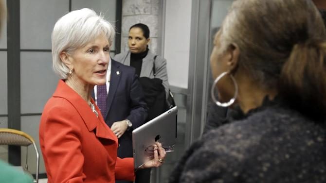 FILE - In this Feb. 3, 2014 file photo, Health and Human Services Secretary Kathleen Sebelius greets visitors after a news conference on enrollment in affordable health coverage in Cleveland. The Obama administration says about 1 million Americans signed up for private insurance under the president's health care law in January, extending a turnaround from early days when a dysfunctional website frustrated consumers. New numbers released Tuesday show nearly 3.3 million people signed up through Feb. 1. Although enrollment is gaining ground, the government's initial target of 7 million by the end of March still seems like a stretch. (AP Photo/Mark Duncan, File)