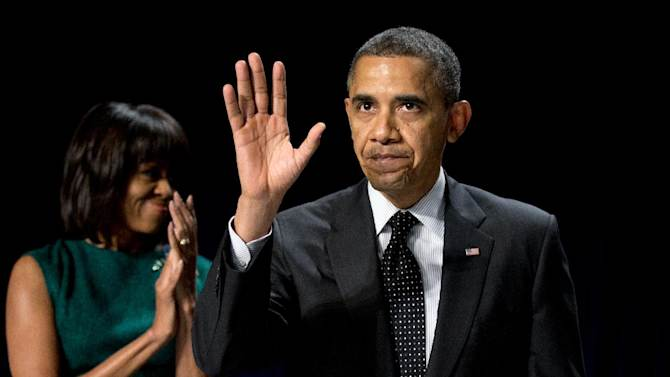 First lady Michelle Obama applauds as President Barack Obama waves after he spokes at the National Prayer Breakfast in Washington, Thursday, Feb. 7, 2013.  (AP Photo/Manuel Balce Ceneta)