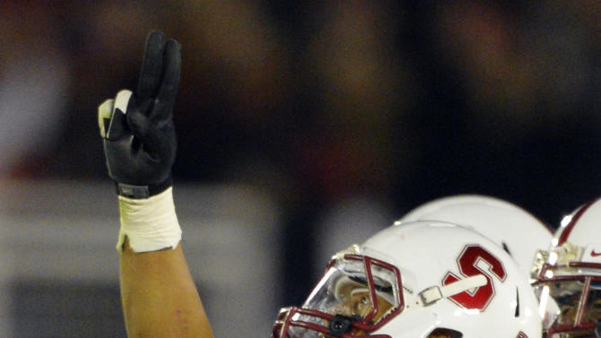 Stanford cornerback Usua Amanam celebrates after a interception against Wisconsin late in the second half of the Rose Bowl NCAA college football game, Tuesday, Jan. 1, 2013, in Pasadena, Calif. Stanford won 20-14. (AP Photo/Mark J. Terrill)