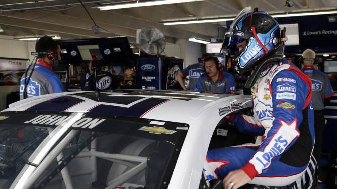 Jimmie Johnson climbs into his car before practice for Sunday's NASCAR Sprint Cup series Coca-Cola 600 auto race at Charlotte Motor Speedway in Concord, N.C., Thursday, May 23, 2013. (AP Photo/Chuck Burton)