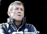 Kenny Dalglish, pictured in April 2012, has called on Liverpool&#39;s supporters to rally behind the club on Thursday following his shock sacking as manager of the Premier League giants