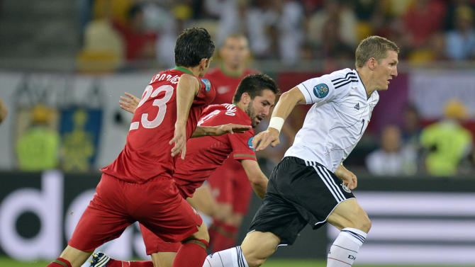 Germany's Bastian Schweinsteiger is followed by Portugal's Portugal's Helder Postiga, left, during the Euro 2012 soccer championship Group B match between Germany and Portugal in Lviv, Ukraine, Saturday, June 9, 2012. (AP Photo/Martin Meissner)