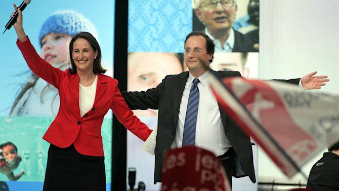 FILE This Thursday March 29, 2007 file photo shows Socialist French presidential candidate Segolene Royal, left, and her companion Secretary-General of the Socialist Party Francois Hollande acknowledge supporters during a meeting in Limoges, central France. The last time France voted for president, Francois Hollande was a portly, smiley man with a wishy-washy image playing second fiddle to Segolene Royal, his Socialist party's candidate and the mother of his four kids. Now he's a man with a trim waistline and promising future who managed a tough presidential debate with the air of, well, a president. (AP Photo/Michel Euler, File)