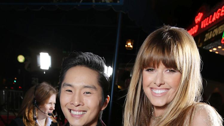 "Justin Chon and Sarah Wright at the LA premiere of ""21 and Over"" at the Westwood Village Theatre on Thursday, Feb. 21, 2013 in Los Angeles. (Photo by Eric Charbonneau/Invision/AP)"