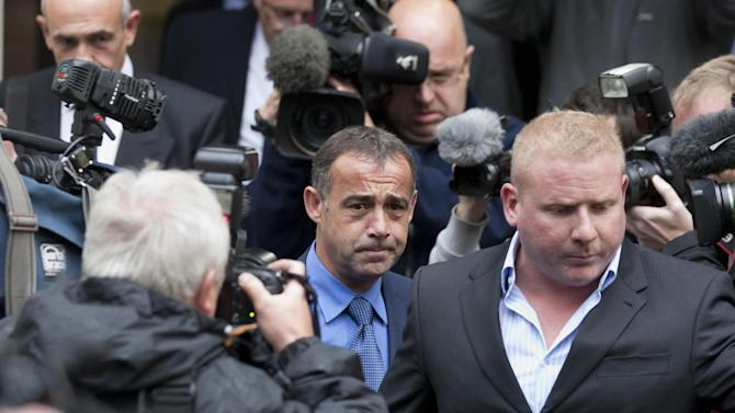 Coronation Street actor Michael Le Vell, centre, makes his way to his car as he leaves Manchester Crown Court, Manchester, England, Monday, Sept. 9, 2013. Le Vell, 48, denies 12 charges including five of rape. The soap star, who has played garage mechanic Kevin Webster in the ITV soap for 30 years, is being tried under his real name Michael Turner. (AP Photo/Jon Super).