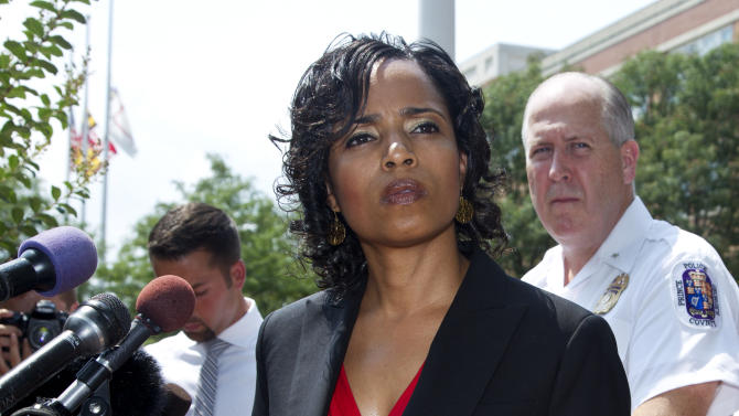 Prince George's County, Md. State Attorney Angela Alsobrooks, left, accompanied by Police Chief Mark Magaw, listens to reporters questions during a news conference at the Prince George's County Courthouse in Upper Marlboro, Md., to provide an update on the status of criminal charges against Neil Prescott Wednesday, Aug. 1, 2012.  Prescott was found last week with multiple firearms and thousands of rounds of ammunition. (AP Photo/Manuel Balce Ceneta)