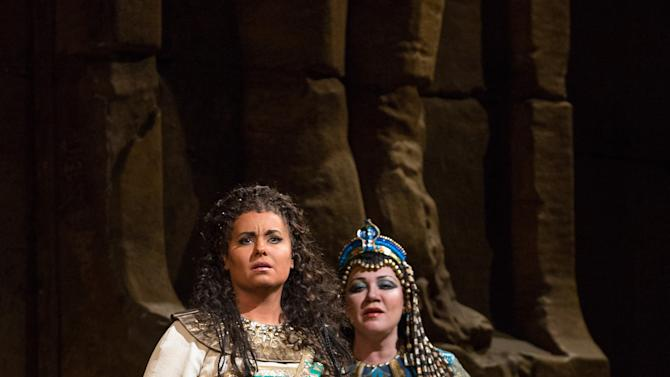 "In this Nov. 15, 2012 photo provided by the Metropolitan Opera, Liudmyla Monastyrska, left, performs in the title role with and Olga Borodina, right, as Amneris in Verdi's ""Aida,"" during a dress rehearsal at the Metropolitan Opera in New York. (AP Photo/Metropolitan Opera, Marty Sohl)"