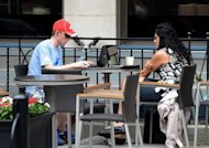 People use their laptop computers at a coffee shop in Washington DC. A Consumer Reports survey released this month found many users of Facebook are unaware of the privacy risks from the massive social network site or fail to take adequate precautions