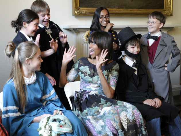 First lady Michelle Obama reacts as she surprises schoolchildren from Willow Springs Elementary School in Fairfax, Va., before they performed part of a play at the Decatur House, a National Trust for