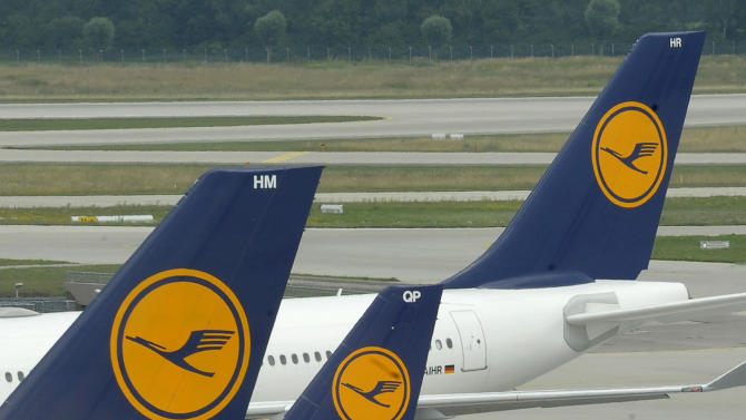 """FILE - This Aug. 1, 2008 file photo shows German airline Lufthansa planes stand on the airfield at the airport in Munich, southern Germany. Lufthansa AG says Thursday, March 15, 2012, it expects lower profits this year as high fuel prices and economic uncertainties weigh on earnings. The company said its operating profit is expected to slide from euro 820 million (US dollar1.1 billion) in 2011 to a """"mid three-figure million euro range"""" in 2012. (AP Photo/Uwe Lein, File)"""
